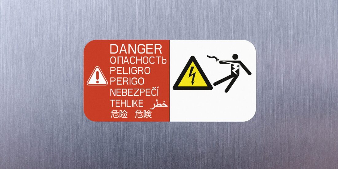 Warning labels caution against risks caused by high voltage